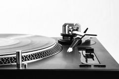 Recordplayer side. Recordplayer with black record, close up of mechanisme of arm Stock Image