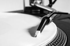 Recordplayer with white record. And headphones on top Royalty Free Stock Photography