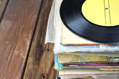 Records stack and old record. vintage filtered. Royalty Free Stock Images