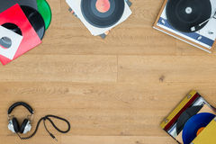 Records With Turntable On Wooden Table Royalty Free Stock Photos
