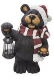 Recorte de la bufanda de la linterna del oso negro de la Navidad Fotos de archivo