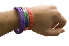 Recorte de los wristbands de la caridad Imagen de archivo libre de regalías