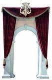 Recorte rojo de las cortinas y del arco del terciopelo imagen de archivo