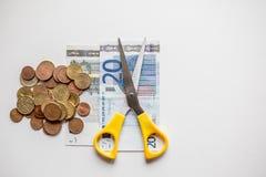 Recortes presupuestarios euro del dinero Imágenes de archivo libres de regalías