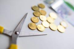 Recortes presupuestarios euro del dinero Fotografía de archivo libre de regalías
