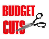 Recortes presupuestarios - tijeras aisladas Foto de archivo