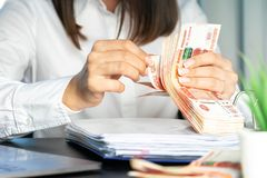 Woman working at office. Recount of bank note. Hand giving money close up. Payment of goods royalty free stock photo