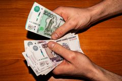 Recount of bills in the hands of the Russian currency stock images