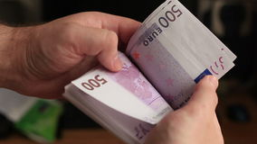 Recount of pack of 500 euros banknotes stock video