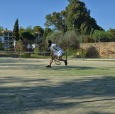 Recovering a ball in a tennis match Royalty Free Stock Photography