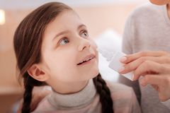 Curious recovering child with nasal drops Royalty Free Stock Photo
