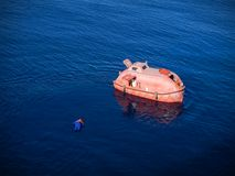 Save me. Recovering a person from the water. Dummy in the water. This is a compulsory safety drill for all vessels Stock Image