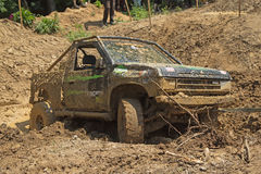 Recovering the vehicle from the muddy terrain Stock Images