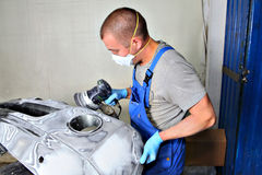 Recovery of damaged vehicle, Polishing bumper car at automobile stock photography