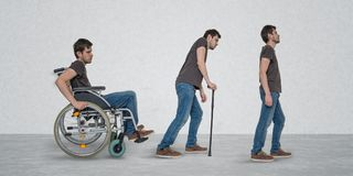 Recovery of handicapped disabled man on wheelchair royalty free stock image