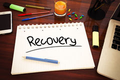 Recovery. Handwritten text in a notebook on a desk - 3d render illustration Royalty Free Stock Image