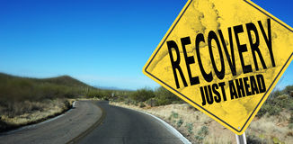 Recovery Just Ahead sign. On desert road Royalty Free Stock Image