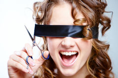 Recovery of one's sight. Portrait of woman shouting and with cutting black bandage on eyes Royalty Free Stock Image
