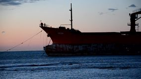 Recovery operations of a cargo ship aground stock video