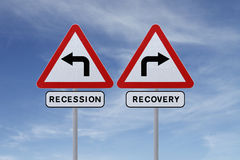 Recovery or Recession. Conceptual road signs on economic recovery and recession stock photos