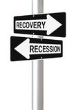 Recovery or Recession. Conceptual one way road signs on economic recovery and recession royalty free stock photos