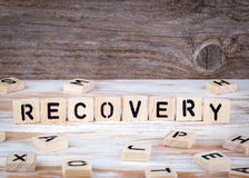 Recovery from wooden letters Royalty Free Stock Image
