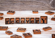 Recovery from wooden letters Royalty Free Stock Images