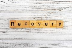 Recovery word made with wooden blocks concept Royalty Free Stock Image