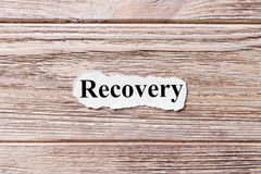 Recovery of the word on paper. concept. Words of Recovery on a wooden background royalty free stock photography