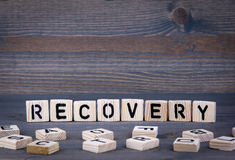 Recovery word written on wood block Stock Image