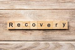Recovery word written on wood block. recovery text on table, concept royalty free stock photos