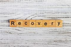 Recovery Word Written In Wooden Cube concept Stock Image