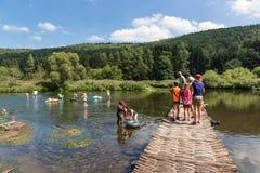 Recreating people near the riverside of river Semois, Belgium Stock Image