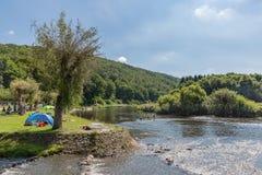 Recreating people near the riverside of the river Semois, Belgium Royalty Free Stock Photo