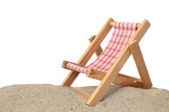 Recreation. A standard deck chair standing on a beach. All isolated on white background Stock Photography