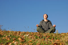 Recreation. Sitting woman recreates  in nature Royalty Free Stock Photo