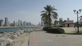 Recreation area along the bay in Dubai, United Arab Emirates. On the other side of the modern area of the marina. Tourism, holidays, sights, impressions for royalty free stock photo