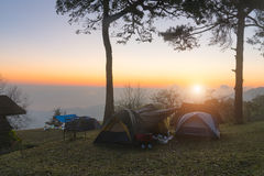 recreation area and camp with tent, sunset time with rising sun royalty free stock photography