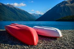 A recreation area with a couple colorful kayaks Stock Image