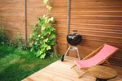 Free Recreation Area In The Yard Of The House: Chairs, Barbecue, Table Royalty Free Stock Image - 196010196