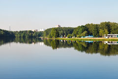 Recreation area on lake beach in city. In sunny summer day Stock Photo