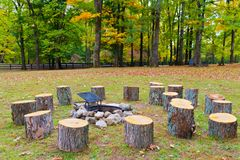 Recreation area in park with fire pit. Recreation area in park with fire pit and stumps. Autumn landscape Royalty Free Stock Image