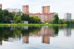 Recreation area on shore of the city pond. Green recreation area on shore of the city pond. Big Garden (Academic) Pond, Moscow Stock Photo