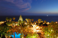 Recreation area with swimming pools and beach. Of luxury hotel during sunset, Tenerife island, Spain Stock Photos