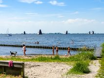Recreation on a beach at the Heegermeer in Friesland in the north of the Netherlands stock image
