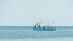 Recreation boat, ship sailing on Black Sea, blue water, sunny day and clear sky. Stock Photo