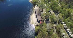 Recreation center on the shore of the lake in the forest zone stock video footage
