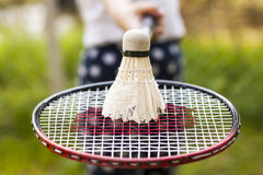Recreation concept. Close up of badminton racket with shuttlesock Royalty Free Stock Photo