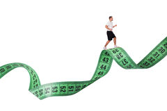 Recreation Concept. Man running on measure tape as recreation concept Stock Photos