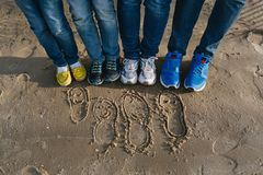 Recreation family on beach. Recreation of a sports family on a sandy beach Royalty Free Stock Photography